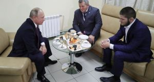 Russian president Vladimir Putin speaks with  Khabib Nurmagomedov  and his trainer and father Abdulmanap Nurmagomedov in Ulyanovsk, Russia. Photograph: Mikhail Klimentyev/EPA/Sputnik/Kremlin pool