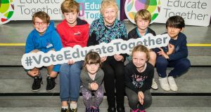 Prof Áine Hyland, one of the founding parents of the   Dalkey School Project, with David Rankin (10), Dylan O'Broin (11), Emily Roarty (5), Sophie Roarty (8), Matt O'Broin (7) and Oliver Donohue (9) at Educate Together's 40th anniversary event. Photograph: Brendan Lyon/ImageBureau
