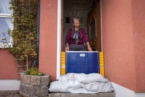 Nancy Long at the door of her house in the Claddagh Quay, Galway, with sandbags and a plastic flood gate for protection against possible flooding from storm Callum. Photograph: Andy Newman