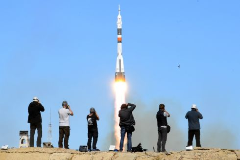 Photographers take pictures as Russia's Soyuz MS-10 spacecraft carrying the members of the International Space Station expedition blasts off. Photograph: Kirill Kudryavtsev/AFP/Getty Images