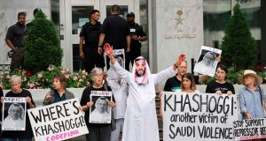 A demonstrator dressed as Saudi crown prince Mohammed bin Salman protests with others outside the Saudi embassy in Washington  on Monday. Photograph: Jim Watson/AFP/Getty Images
