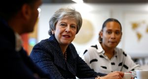 Britain's prime minister Theresa May talks to employees at advertising agency WPP on Thursday as she launches her government's Race at Work Charter.  Photograph: Henry Nicholls/AFP/Getty Images