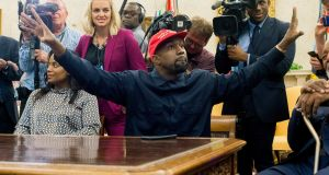 US rapper Kanye West (C) speaks to members of the press during a meeting in the Oval Office of the White House, in Washington, DC. Photograph: Michael Reynolds/EPA
