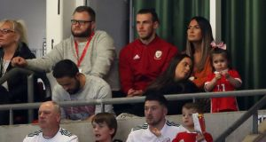 Wales' Gareth Bale sits in the stand during their 4-1 defeat to Spain and is set to miss the Nations League match against Ireland. Photo: Nick Potts/PA Wire