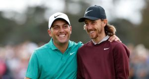 Francesco Molinari and Tommy Fleetwood of England laugh together on the second green during the first round of the 2018 British Masters at Walton Heath. Photo: Luke Walker/Getty Images