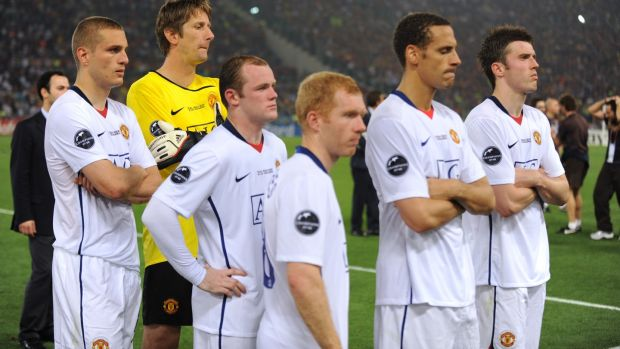 Manchester United players, including Carrick (far right), stand dejected after the Champions League final defeat to Barcelona in 2009. Photo: AMA/Corbis via Getty Images
