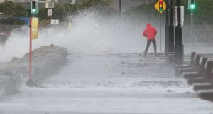 A man avoids the waves at Salthill promenade, Co Galway during Storm Callum. Photograph: Brian Lawless/PA Wire