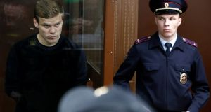 Russian soccer player Alexander Kokorin, who was detained and accused of carrying out attacks, attends a court hearing in Moscow on Thursday. Photo: Sergei Karpukhin/Reuters