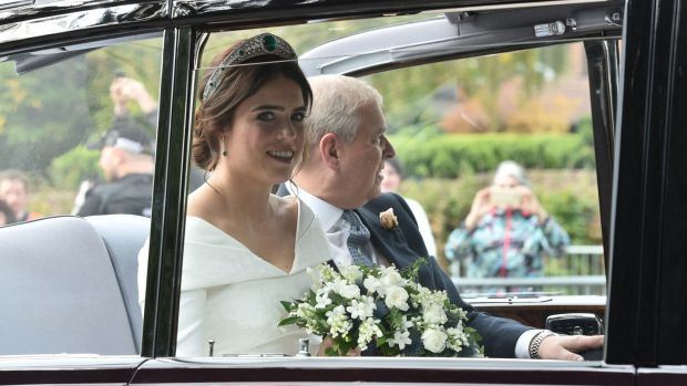 Princess Eugenie rides in a car on her way to marry Jack Brooksbank. Photograph: PA