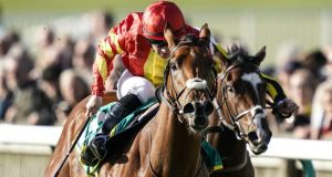 Wayne Lordan partners Iridessa to victory in the Fillies' Mile at Newmarket. Photograph: Alan Crowhurst/Getty