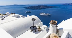 Cruise ships pass Santorini Island in Greece