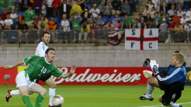Ireland's Robbie Keane scores past Germany's Oliver Kahn, watched by Thomas Linke, during their Group E match at the World Cup Finals in Japan in June 2002. The match ended in a 1-1 draw. Photograph: Kieran Doherty/Reuters
