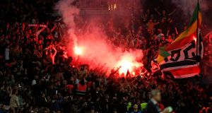 Flares are lit by PSG fans in the stands during the  Champions League Group C  match against  Red Star Belgrade at the Parc des Princes stadium in Paris. Photograph: Yoan Valat/EPA