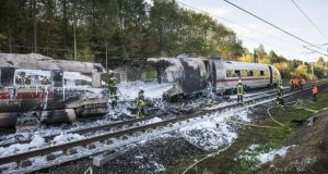 The burnt-out wreckage of a passenger car of an ICE high-speed train  near Montabaur, Germany. A fire reportedly broke out in the rear passenger carriage of the Deutsche Bahn train en route from Cologne to Munich on on October 12th. All 500 passengers were safely evacuated. Photograph: Thomas Lohnes/Getty