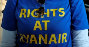 A Ryanair worker taking part in a protest in Valencia, Spain, in September. Photograph: Heino Kalis/File Photo/Reuters