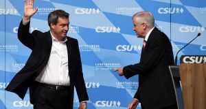 Bavarian governor Markus Söder and German interior minister Horst Seehofer, at  a final election rally in Munich, on Friday.  Photograph:  Christof  Stache/AFP/Getty Images