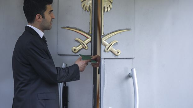 A man takes a passport from the door of the Saudi Arabia's consulate in Istanbul, Turkey. Photograph: Getty Images.