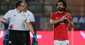 Egypt's Mohamed Salah applauds fans as he leaves the pitch due to injury. Photograph: Mohamed Abd El Ghany/Reuters