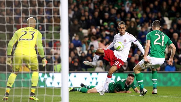 Kevin Long blocks a late Yussuf Poulsen shot. Photograph: Bryan Keane/Inpho