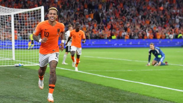 Memphis Depay celebrates his goal in Holland's 3-0 win over Germany. Photograph: Emmanuel Dunand/AFP/Getty
