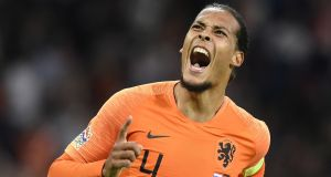 Netherlands' Virgil van Dijk celebrates after scoring the opening goal during the  Nations League  match against  Germany,  at Johan Crujiff ArenA in Amsterdam. Photograph: John Thys/AFP/Getty Images