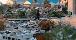 Henry Penafiel, a member of the FEMA emergency response  amid ruins in the aftermath of Hurricane Michael in Mexico Beach. Photograph: AP