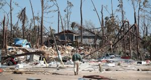 A first responder looks at damage following Hurricane Michael on Mexico Beach in  Florida. Photograph: Getty images