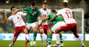 Ireland's Shane Long is challenged by Thomas Delaney and Lasse Schone of Denmark during the Nations League match at the Aviva stadium. Photograph:  Ryan Byrne/Inpho