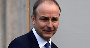 Fianna Fáil leader Micheál Martin said he wanted the Taoiseach to agree not to collapse the Government while the Brexit talks are ongoing. Photograph: Reuters