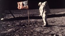 Buzz Aldrin with  the US flag deployed on the moon: space is no place for narrow nationalistic agendas. Photograph: Neil Armstrong/Nasa