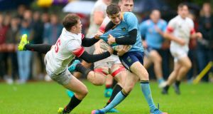 UCD's Thomas Foley is tackled by Dublin University's Rob Russell. Photograph: Oisin Keniry/Inpho