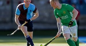 Glenannne's David Keogh  (right) scored a penalty stroke in his side's 6-2 win over Pembroke. Photograph: Inpho