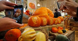 PUMPKIN PATCH POLITICS: President Michael D. Higgins and the other presidential contenders carved into Halloween pumpkins at Fallon & Byrne's Exchequer Street Store, Dublin.  Photograph: Nick Bradshaw/The Irish Times