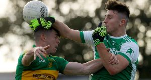 Rhode's Conor McNamee and Oisín Kelly of Ferbane battle for possession during the  Offaly SFC Final at  Bord na Mona O'Connor Park in  Tullamore. Photograph: Lorraine O'Sullivan/Inpho