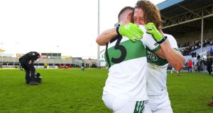 Portlaoise's Ricky Maher and Cahir Healy celebrate their side's Laois SFC final win over O'Dempsey's. Photograph: Ken Sutton/Inpho