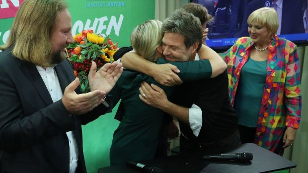 Katharina Schulze and Ludwig Hartmann, co-lead candidates of the Bavarian Green Party embrace as leading members of the federal Green Party Anton Hofreiter (left) and Claudia Roth look on in Munich, Germany. Photograph: Sean Gallup/Getty Images