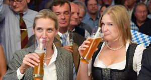 Alice Weidel, co-Bundestag faction leader and  Katrin Ebner-Steiner, deputy chairman of the right-wing Alternative for Germany (AfD) political party as initial results from the Bavarian state elections are announced in Mamming, Germany. Photograph: Sebastian Widmann/Getty Images