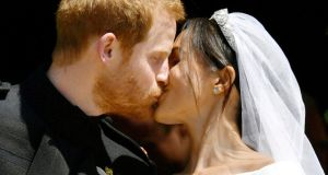 Prince Harry and Meghan Markle kiss on the steps of St George's Chapel in Windsor Castle after their wedding in Windsor, Britain, May 19th, 2018. Photograph: Ben Birchall/Pool via Reuters