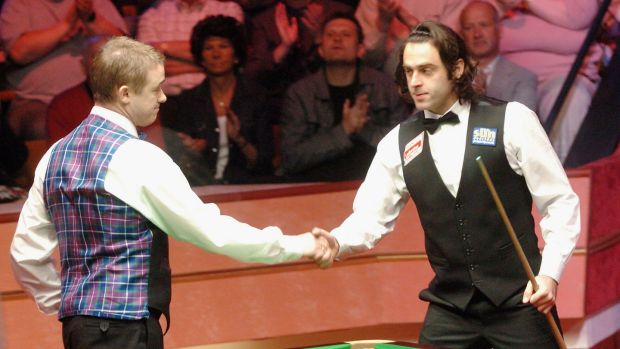 Stephen Hendry congratulates Ronnie O'Sullivan after his semi-final defeat in the 2004 World Championships. Photograph: Matthew Lewis/Getty