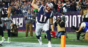 Julian Edelman of the New England Patriots spikes the football after scoring a touchdown in the second quarter against the Kansas City Chiefs. Photograph: Adam Glanzman/Getty Images