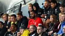 Billy Vunipola and Mako Vunipola of Saracens look on from the stands after sustaining injuries during the Champions Cup match between Glasgow Warriors and Saracens. Photograph:  David Rogers/Getty Images