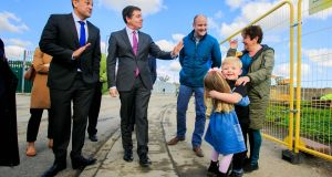 GARDEN VISIT: Taoiseach Leo Varadkar with Minister for Finance Paschal Donohoe greet local residents Rose O'Connor and her grandchildren Lily O'Connor (4) and Brandon O'Connor (3) during a visit to the O'Devaney Gardens project in Dublin 7. The Project will see the demolition of the housing blocks & the development of just under 700 social, affordable and private homes on the site. Photograph: Gareth Chaney/Collins