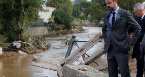 French Prime Minister Edouard Philippe, who is also interim Interior Minister, reacts as he inspects the damage after flash floods hit the southwestern Aude district of France. Photograph: Reuters