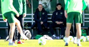 Republic of Ireland manager Martin O'Neill and injured Callum O'Dowda watch the squad train ahead of their Nations League match against Wales. Photograph: Ryan Byrne/Inpho