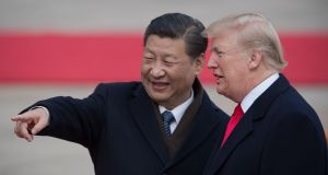 China's president Xi Jinping and US president Donald Trump     in Beijing in 2017. The  leaders are expected to meet at the G20 summit in Buenos Aires for their first face-to-face meeting since August. Photograph: Getty Images