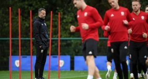 Ryan Giggs looks on as his team train during in Cardiff on Monday. Photoraph: Stu Forster/Getty Images