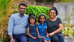 New to the Parish: Swathi Sasidharan with her husband, Sajeevan Achuthan, and children, seven-year-old Aadvika and four-year-old Anwita. Photograph: Tom O'Hanlon