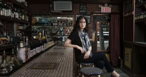 Kara Newman, the author of 'Nightcap', at the East Village bar Amor y Amargo. Photograph: Sasha Maslov for The New York Times