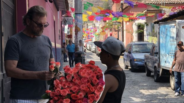 'Catching a glimpse of the man I love buying roses on a street festooned with papel picado, I knew I was home.'