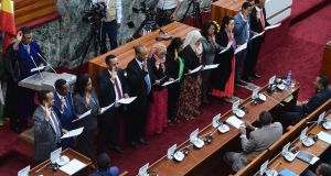 Ethiopia's newly appointed ministers take their oath of office in   the parliament in  Addis Ababa on Tuesday. Photograph: AFP/Getty Images
